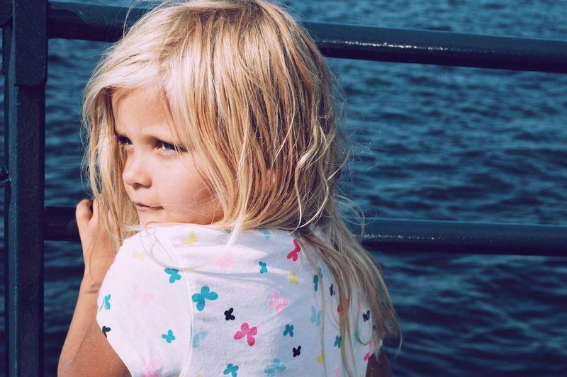 Portrait of cute girl in water