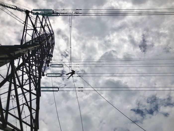 Working at height Man At Work Working At Heights Cable Cloud - Sky Electricity  Power Line  Sky Low Angle View Connection Power Supply Fuel And Power Generation No People Electricity Pylon Technology Nature Day Outdoors Metal Complexity Power Pole Telephone Line