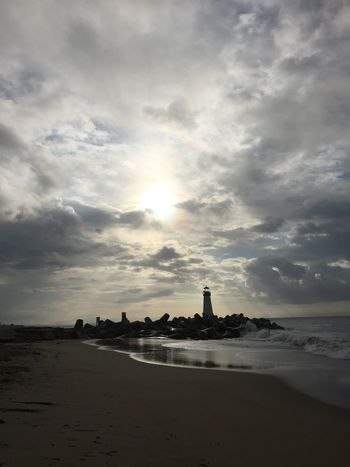 Walton Lighthouse 3 Atmosphere Atmospheric Mood Beach Beachphotography Cloud Cloud - Sky Cloudscape Cloudy Dramatic Sky Horizon Over Water Lighthouse Majestic Moody Sky Outdoors Power In Nature Sand Silhouette Sky Storm Cloud Sun Sun_collection Sunbeam Sunset Waves, Ocean, Nature Weather