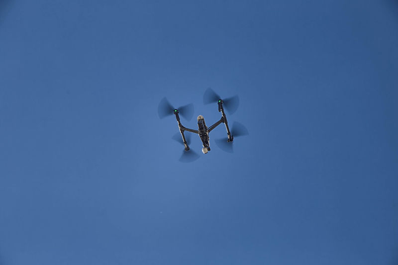 Low Angle View Of Drone Flying In Clear Sky