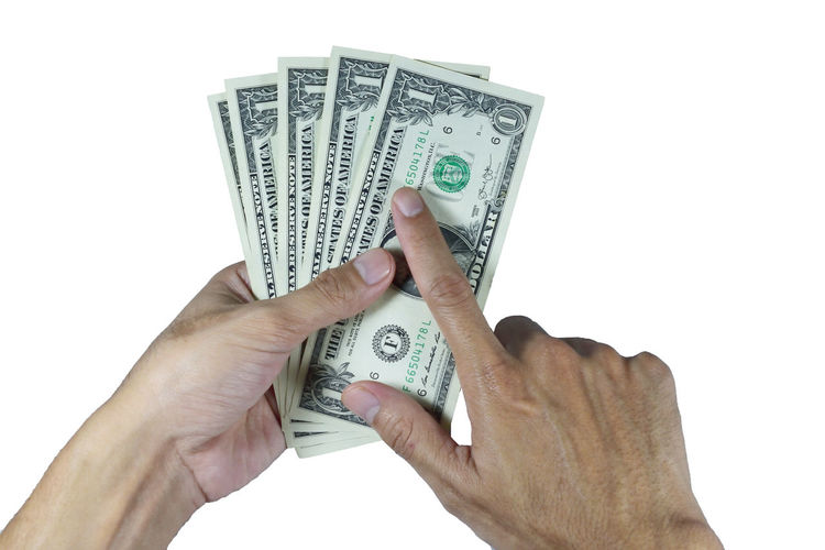 Hand holding dollar on white background in concept saving money investment shopping pay and people richness banknote Shopping Body Part Business Close-up Currency Dollar Dollar Sign Finance Finger Hand Holding Human Body Part Human Finger Human Hand Indoors  Money One Person Paper Currency Pay Saving Saving Money Savings Studio Shot Wealth White Background