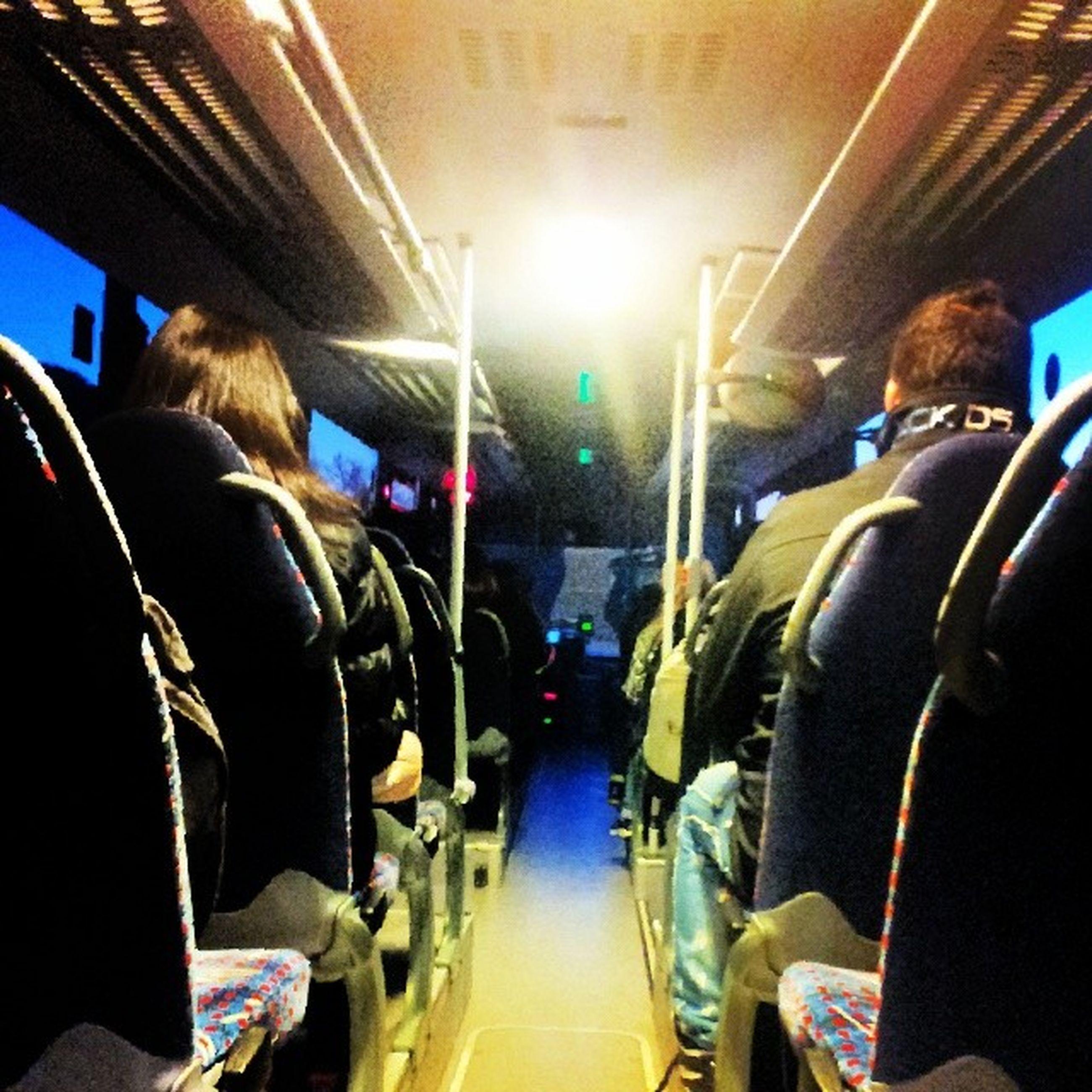 lifestyles, men, indoors, transportation, leisure activity, person, large group of people, mode of transport, vehicle interior, medium group of people, travel, rear view, passenger, togetherness, sitting, illuminated, land vehicle, public transportation, journey
