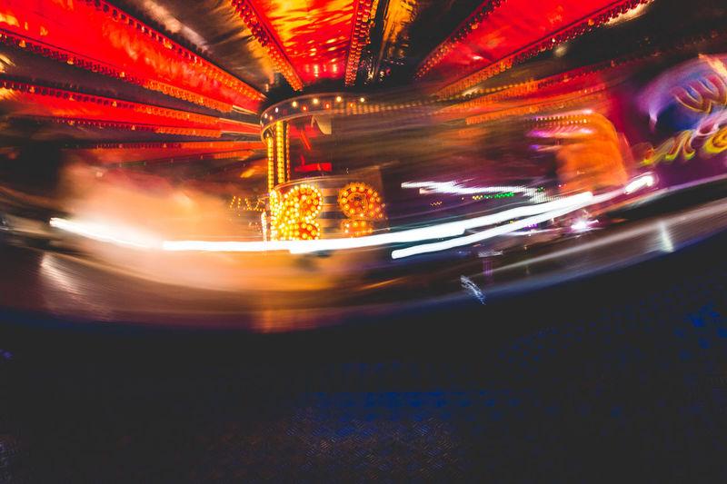 'The Waltzer' fairground ride at Banbury's Michaelmas street funfair. Fairground Attraction Funfair Michaelmas Fair Night Lights Nightphotography The Waltser The Waltzer Amusement Park Amusement Park Ride Banbury Blurred Lights Blurred Motion Carousel Entertainment Fair Fair Attraction Fair Ride Fairground Fairground Ride Illuminated Merry-go-round Neon Lights Night Speed