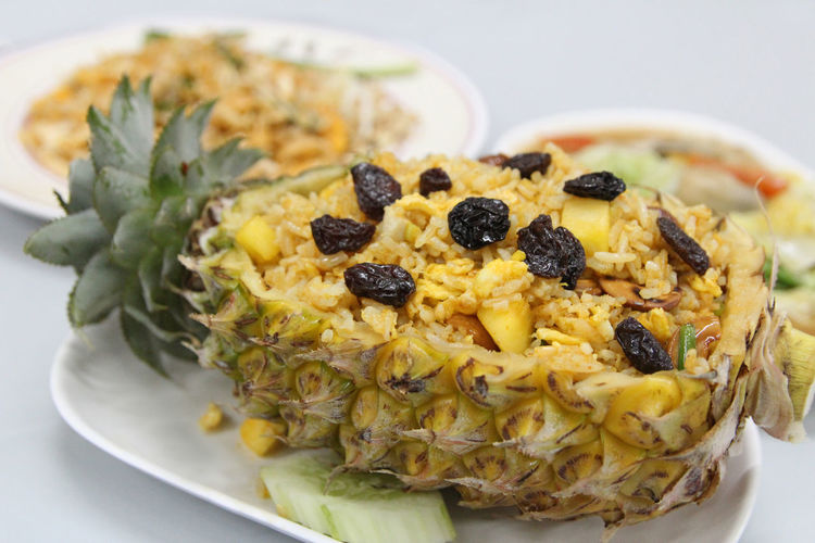 Thai pineapple fried rice with the pineapple, cashew nut, egg and raisin on top Bangkok Close-up Crockery Dried Food Food Food And Drink Freshness Fruit Healthy Eating Indoors  Indulgence Meal No People Pineapple Pineapple Rice Plate Raisin Ready-to-eat Serving Size Still Life Studio Shot Temptation Thai Food Vegetarian Food Wellbeing