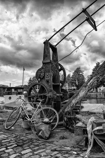 Architecture Bathurst Basin Landing Bicycle Black & White Bristol, England Built Structure Cloud Cloudy Crane Day Deterioration Docks No People Old Outdoors Overcast Parked Parking Sky Stationary Urban Waterfront