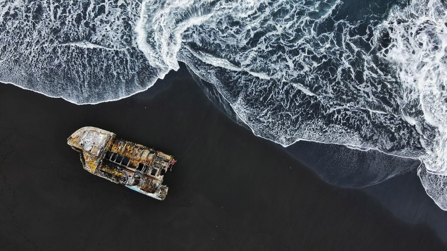 High angle view of wrecked ship  at the beach