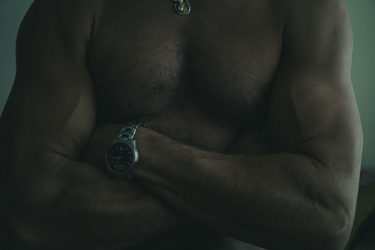 Close-up of shirtless man against blurred background