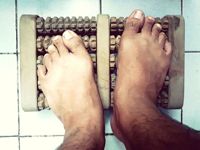 foot massage roller machine wooden tool plantar reflexology Foot Machine Massage Therapy Roller Massages Wooden Wooden Tools Plantar Reflexology Care Healthy Lifestyle Healthy Health Old Vintage Vintage Style Life Lifestyle Background Wall Thailand Asian  Knowledge Low Section Human Leg barefoot Human Foot Men Close-up Sole Of Foot