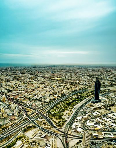 Battle Of The Cities Kuwait Kuwait City كويت الكويت مدينة_الكويت City Built Structure Architecture Cityscape Building Exterior Sky Aerial View Cloud - Sky Travel Destinations Crowded Outdoors Scenics Wide Shot Blue Wide Day City Life Capital Cities  No People Mobility In Mega Cities