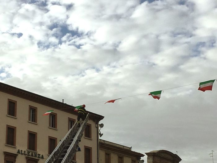 4 November 2016 Forzearmate Pompiere Bandiera Italia Low Angle View Sky Flag Patriotism Cloud - Sky Building Exterior Flying Day Built Structure Architecture No People Outdoors