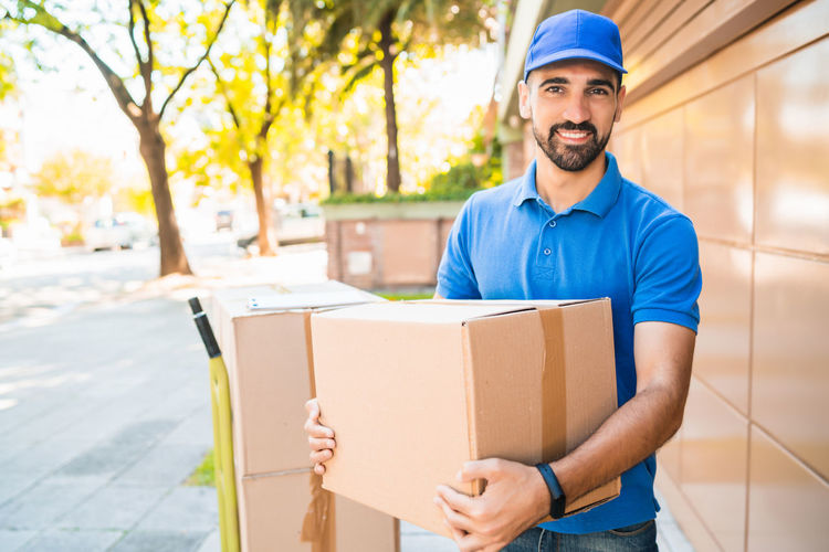 Portrait of young man standing in box