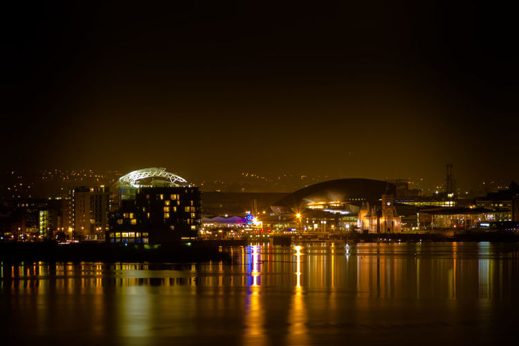 Across Cardiff Bay at night Amber Color Amber Light Architecture Building Exterior Cardiff Bay City Cityscape Dark Darkness Darkness And Light Illuminated Long Exposure Marina Night Night Photography Reflection Street Lights Water Waterfront