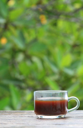 Black Tea Close-up Coffee Coffee - Drink Coffee Cup Crockery Cup Day Drink Focus On Foreground Food And Drink Freshness Glass Hot Drink Mug No People Non-alcoholic Beverage Refreshment Still Life Table Tea Tea - Hot Drink Tea Cup Wood - Material