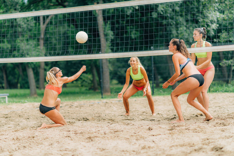 Young women playing beach volleyball