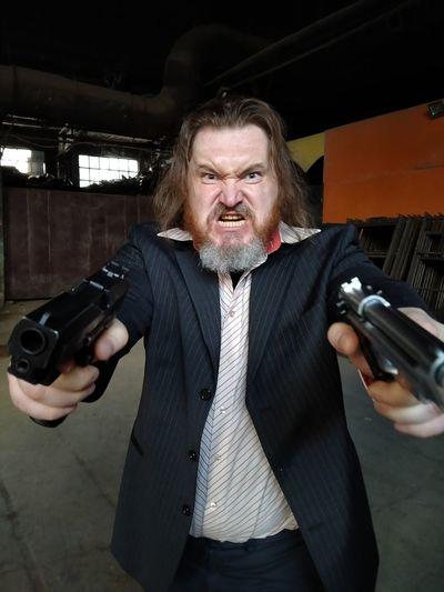Portrait of mid adult man holding camera