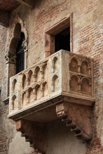 Juliet's balcony - Verona - Italy Arch Arched Architectural Column Architecture Arena Balcony Building Exterior Built Structure City Coluseum Day Exterior Façade Historic Historic Building History Italy No People Old Outdoors Repetition Romeo And Juliet The Past Verona Window