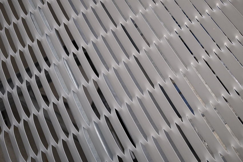 white steel grating Iron Mesh Abstract Background Grate Grating Gray Metal Pattern Perforated Steel Surface Texture