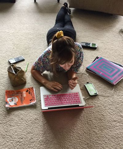 Homework- industrious teen Full Length Vertical Indoors  Child High Angle View One Person Looking Down Education People Day Formula Teen Girl Smart Girl Enjoy The New Normal