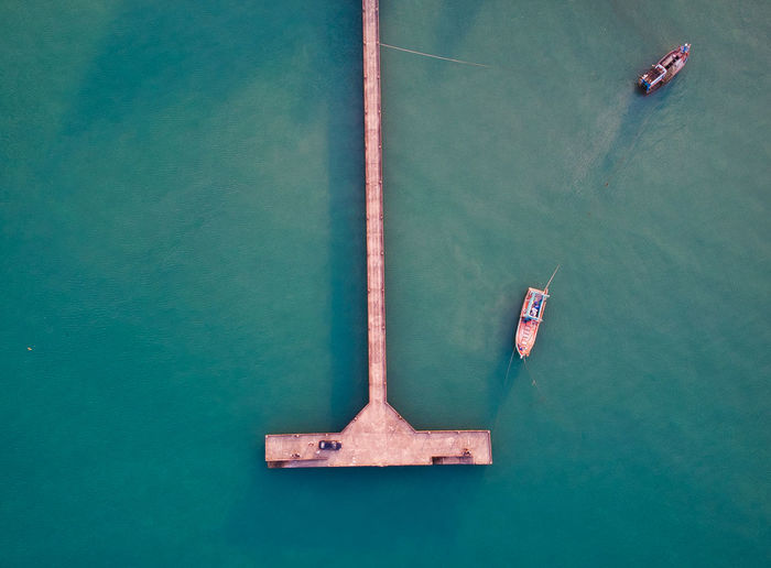 Directly above shot of boats and pier on sea