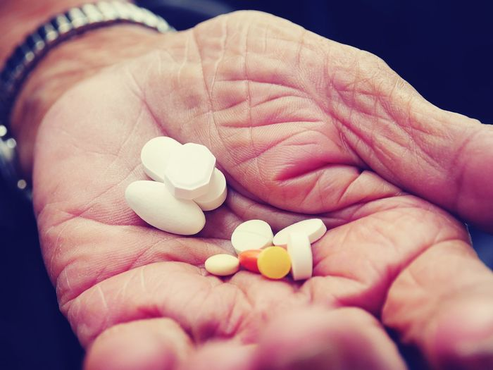 Cropped hand holding medicines