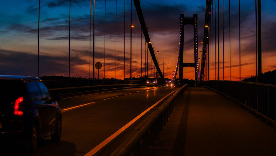 Askøy bridge Sky Transportation Sunset Cloud - Sky Mode Of Transportation Motor Vehicle Car Land Vehicle No People Nature Motion on the move Orange Color City Road Travel Architecture Illuminated The Way Forward Street