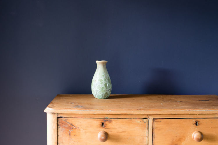 Close-Up Of Vase On Wooden Table