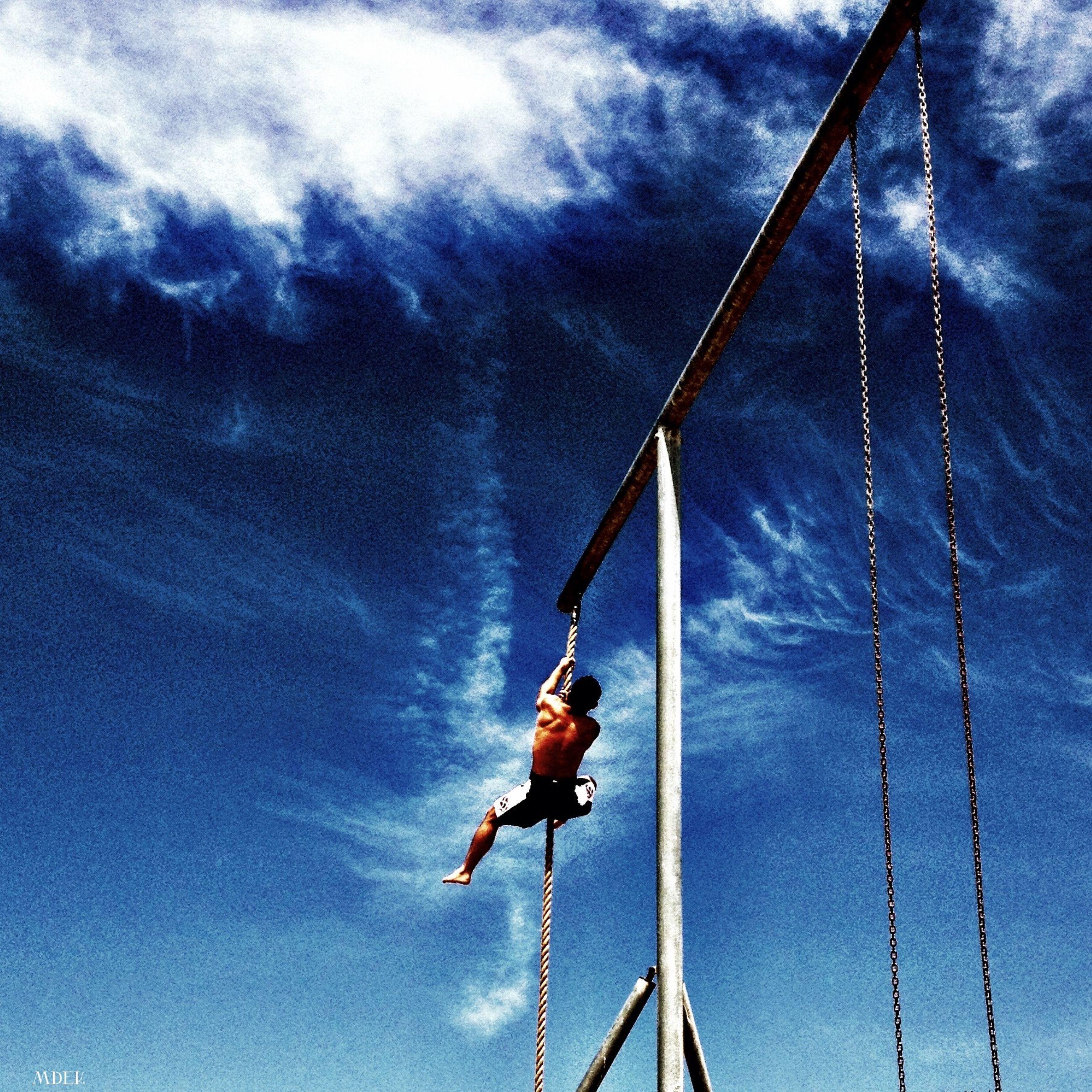 sky, low angle view, leisure activity, lifestyles, cloud - sky, men, nautical vessel, rope, cloudy, cloud, full length, adventure, blue, enjoyment, transportation, fun, day, mast