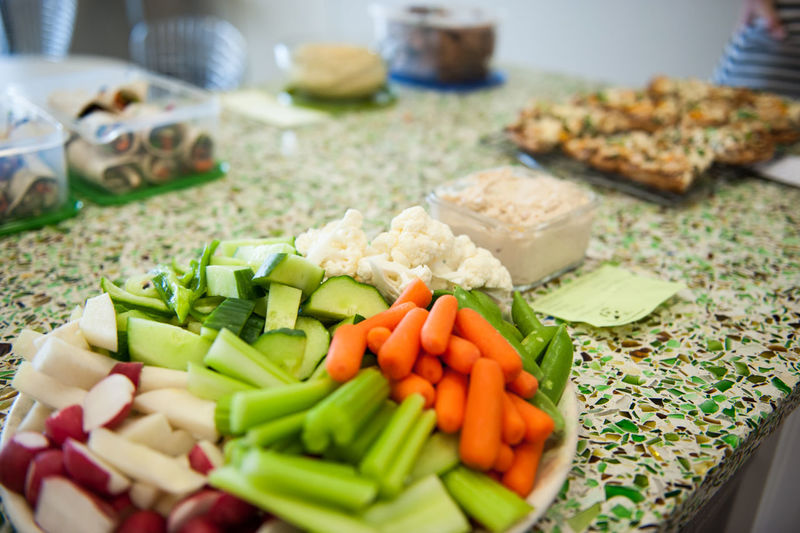Close-up of chopped vegetables on table