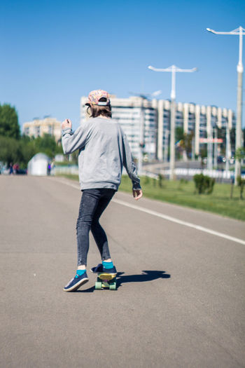 Belarus Minsk Casual Clothing City Day Leisure Activity Lifestyles Motion One Person Real People Riding Road Skateboard Skill  Sky Sport Sports Equipment Sunlight Transportation