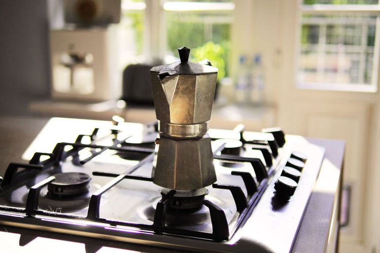 Close-Up Of Coffee Maker On Gas Stove Burner