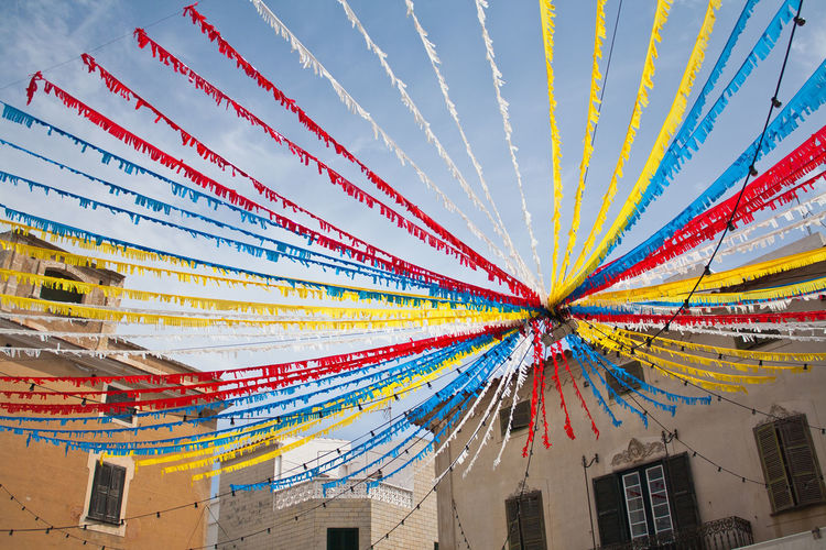 Architecture Arts Culture And Entertainment Built Structure Culture Cultures Design Fiesta Low Angle View Multi Colored Party Partying Ribbons Streamers Tradition
