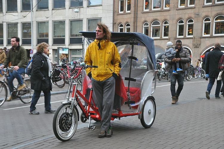 Typical amsterdam bicycle taxi driven by a homeless guy Your Amsterdam Typical Amsterdam Symbol Of Amsterdam Bicycle Bicycle Taxi Netherlands City Life My Amsterdam Welcome To My World My Hometown Homeless Amsterdamcity City Amsterdam City Of Amsterdam Transportation