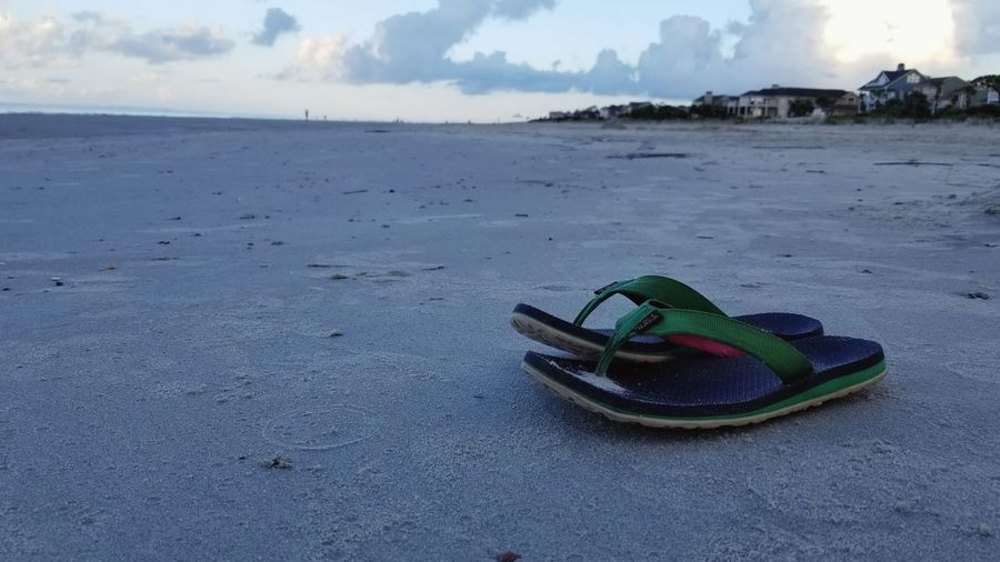 Flipflops Shoes On The Beach Shoes Distance Backgrounds Hilton Head Island, SC Beach Sand Horizon Over Water