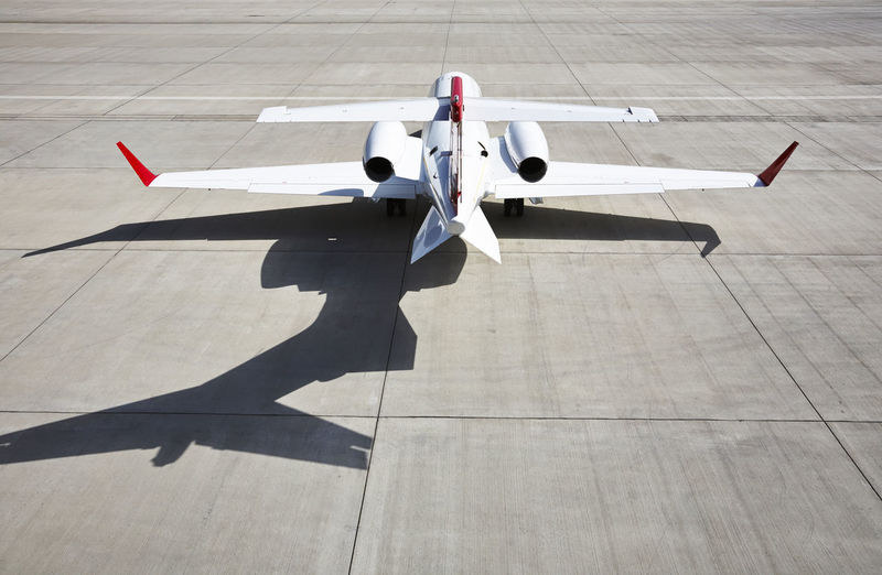 Learjet ready to fly at the airport. Aerospace Industry Air Vehicle Airplane Airport Airport Runway Asphalt Day Flight Fly High Angle View Learjet No People Outdoors Private Jet Shadow Sunlight
