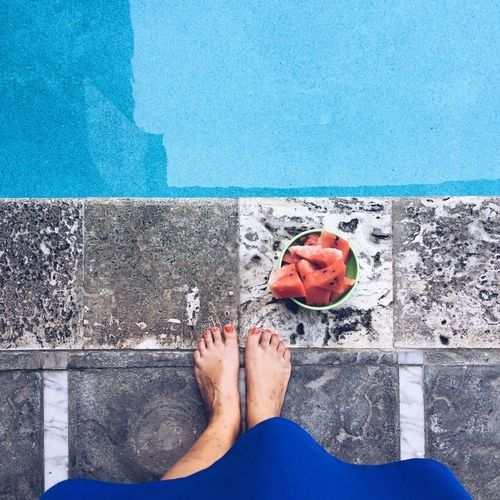View from above, Caucasian woman in a blue dress standing next to a swimming pool and a bowl of watermelon. Panama City, Panama. Square barefoot Beach Blue Day High Angle View Horizon Over Water Human Body Part Human Foot Human Leg IPhoneography Leisure Activity Lifestyles Low Section Mobile Photography One Person One Woman Only Outdoors Personal Perspective Real People Relaxation Sea Standing Summer Swimming Pool Travel Destinations Vacations Water Women