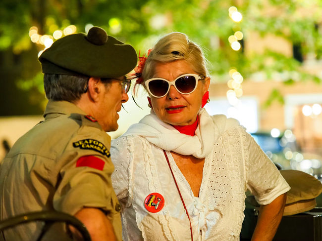 An old man wears military clothes and talks with an old woman that wears old fifties clothes at Summer jamboree event ar senigallia 06 august 2018, Senigallia, Italy Italy❤️ Summer Marche Italy Summer Jamboree Senigallia Senigallia Italy Fifties Old Woman Old Men Old-fashioned Old Man Senigallia Street Photography Street Portrait Street Portraits Fifties Portrait Men Togetherness Friendship Love Looking At Camera Males  Couple Military Parade Military Uniform Army Soldier