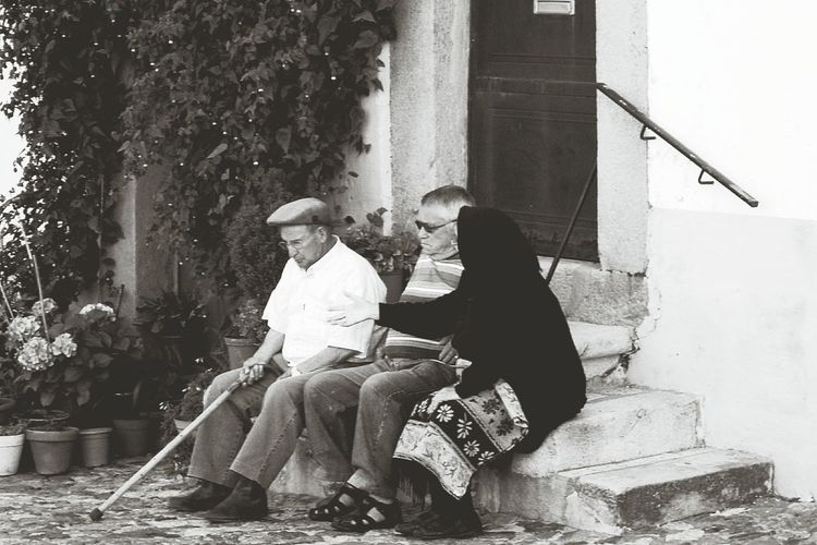 Full length of young couple sitting outdoors