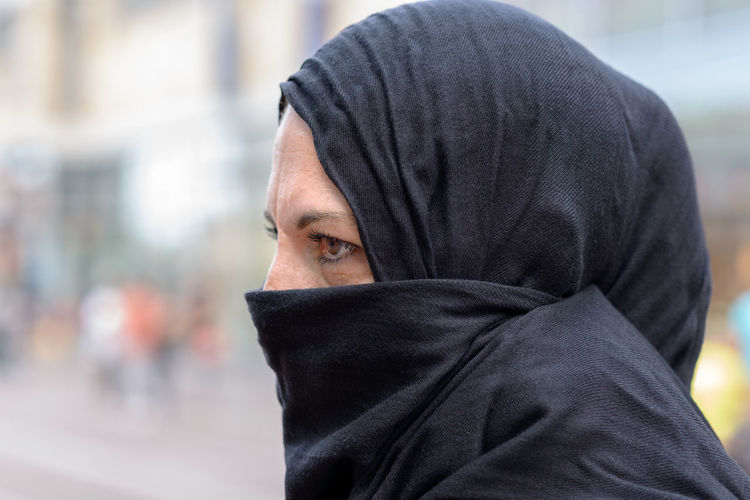 Adult Body Part City Close-up Clothing Contemplation Covering Day Focus On Foreground Headscarf Headshot Hiding Hijab Hood Hood - Clothing Human Body Part Human Face Looking At Camera Obscured Face One Person Outdoors Portrait Veil Young Adult