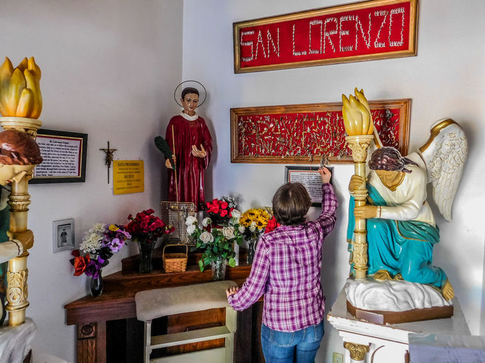 San Lorenzo, Catholic Church, Clint Texas. Saint Lorenzo is the Patron Saint of Cooks Art And Craft Indoors  One Person Women Childhood Lifestyles Representation Child Real People Creativity Sculpture Standing Frame Human Representation Casual Clothing Girls Architecture Picture Frame Statue