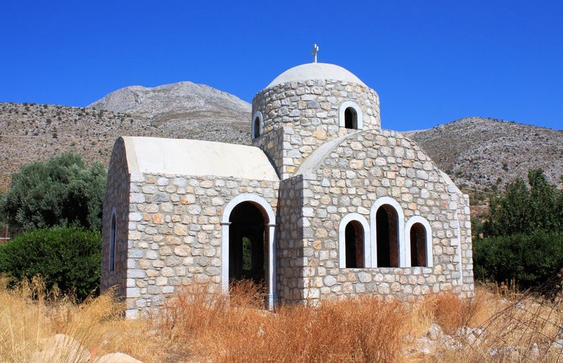 half built church in santorini Church Santorini, Greece Architecture Building Exterior Built Structure Day Dome History No People Not Finish Outdoors Place Of Worship Religion Sky Travel Destinations