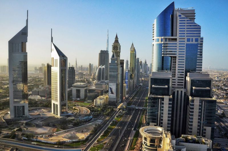 Dubai Skyline 🇦🇪 City Architecture Skyscraper Modern Building Exterior Cityscape Urban Skyline Built Structure Travel Destinations Transportation Tower Travel City Life Outdoors High Angle View No People Downtown District Road Development Clear Sky Skyline Dubai Warm