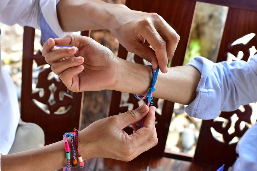 Wrist Knit Wristband To protect the sorrows of the ancient beliefs of Thailand. People Protect Prevent Yarn Threads EyeEmNewHere Belief EyeEm Selects Human Hand Bride Bridegroom Ceremony Togetherness Young Women Women Wedding Life Events Wedding Ceremony Wrist Human Joint