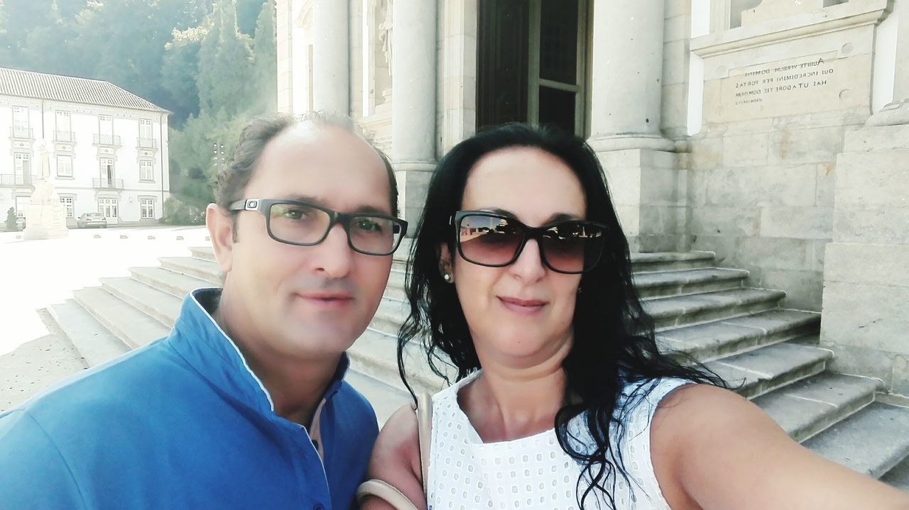 two people, real people, looking at camera, portrait, day, togetherness, lifestyles, outdoors, leisure activity, smiling, happiness, eyeglasses, bonding, building exterior, young women, young adult, close-up