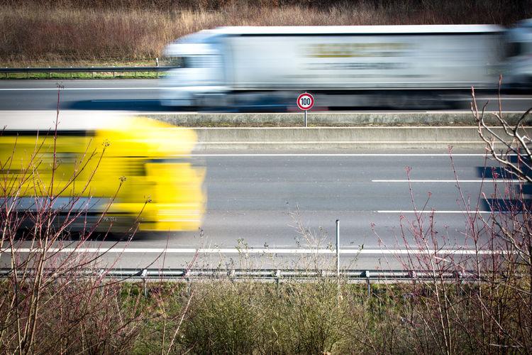 Blur image of trucks on road