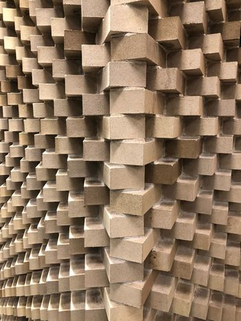 Infinite Subtle Beauty Lobby Rentals Durst Simple Beauty Brickwall Triangle Repetitions Triangle Shape Layers And Textures Raw Materials Architectural Detail Full Frame Stack Pattern Backgrounds Large Group Of Objects Cardboard Box Textured  Indoors  No People Close-up Day