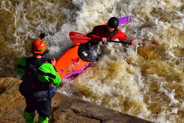 Men in boat on river