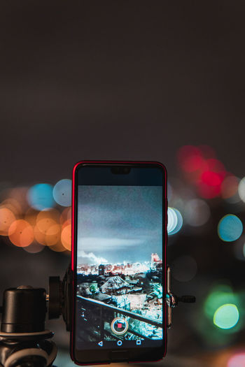 Technology Wireless Technology Smart Phone Communication Illuminated Portable Information Device Photography Themes Screen Mobile Phone Connection Close-up Focus On Foreground City Device Screen No People Photographing Night Light Outdoors Architecture
