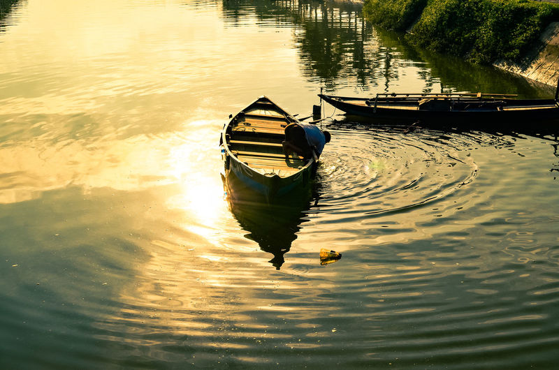 Beauty In Nature Day High Angle View Lake Mode Of Transportation Moored Nature Nautical Vessel No People Outdoors Reflection Rippled Rowboat Sunlight Tranquility Transportation Travel Water Waterfront