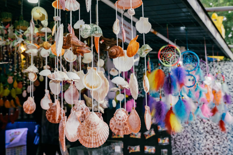 Multi colored decorations hanging at store for sale in market
