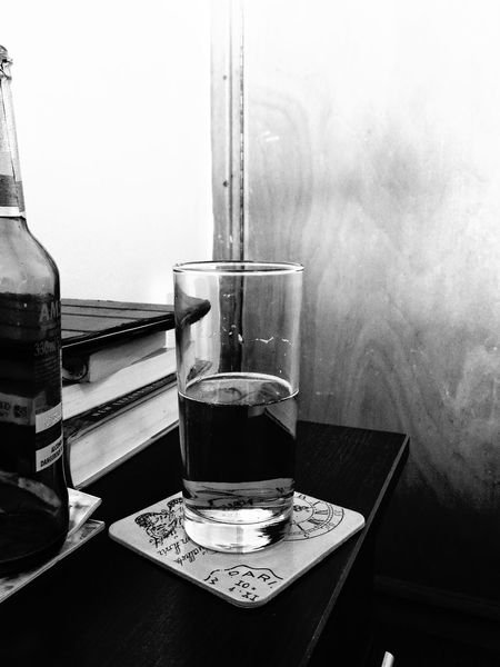 Monochrome Photography Glass With Beer Alcoholic Drink Beer Bottle And Glass Glass Half Full Beer Bottle On Bedside Table On Nightstand